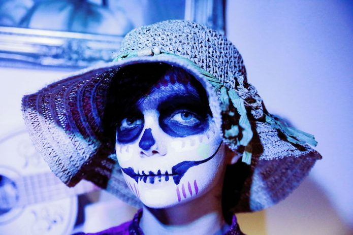 Child dressed up in Day of the Dead style