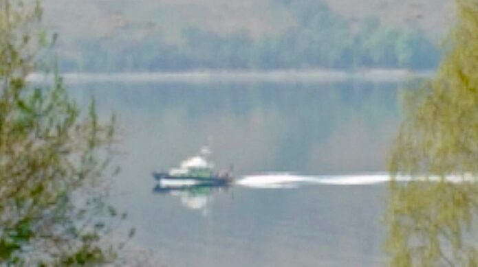 blurred photograph of a boat on Gare Loch, covertly taken by B.D. Owens