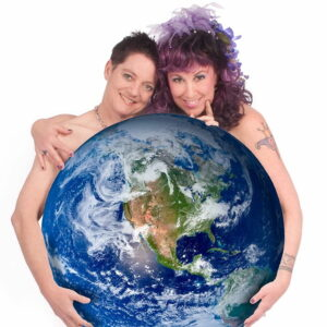 Artists Beth Stephens and Annie Sprinkle holding the earth